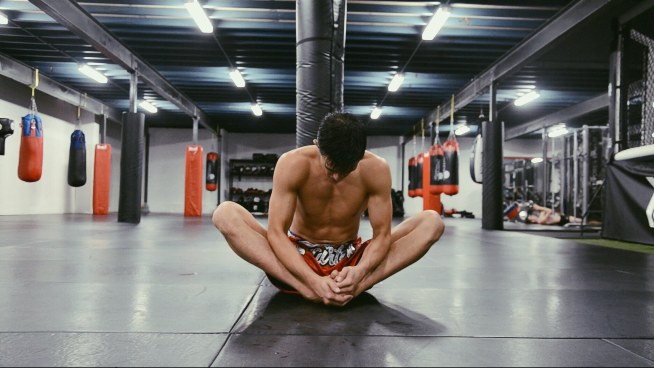 A quiet moment of reflection during his post-workout stretch
