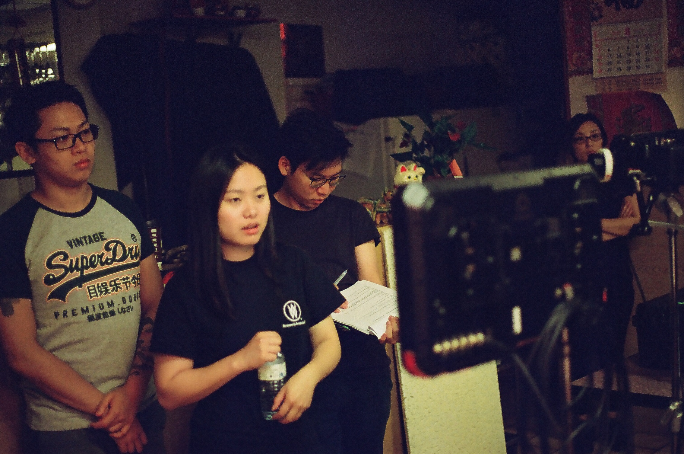 Behind the scenes of Bunny Man (Director Athena Han, script supervisor Anthony Lee and Choreographer observing the shot)