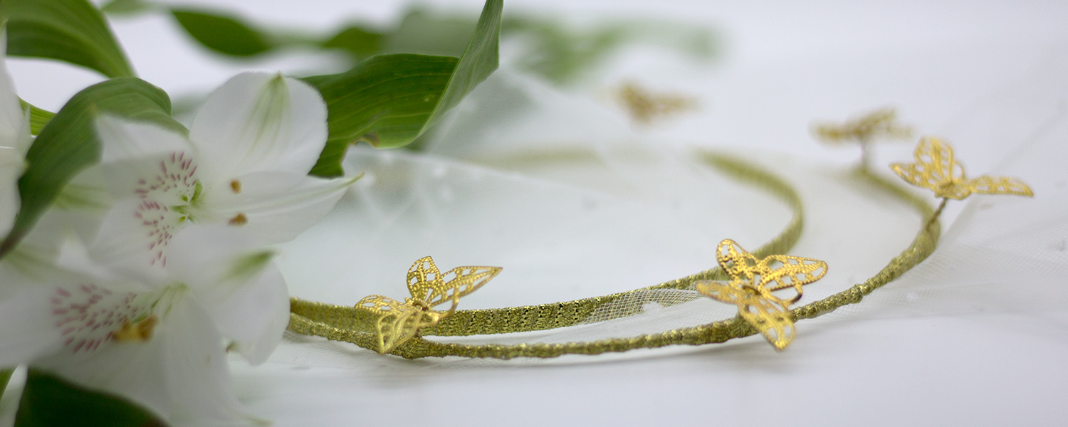 millinery banner_butterfly headband with white flowers.jpg