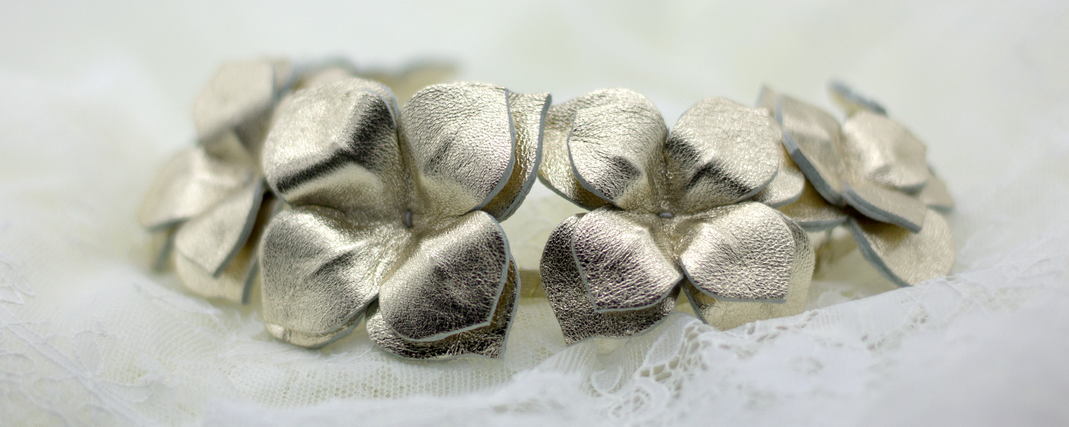 millinery banner_gold leather flower headband on lace.jpg