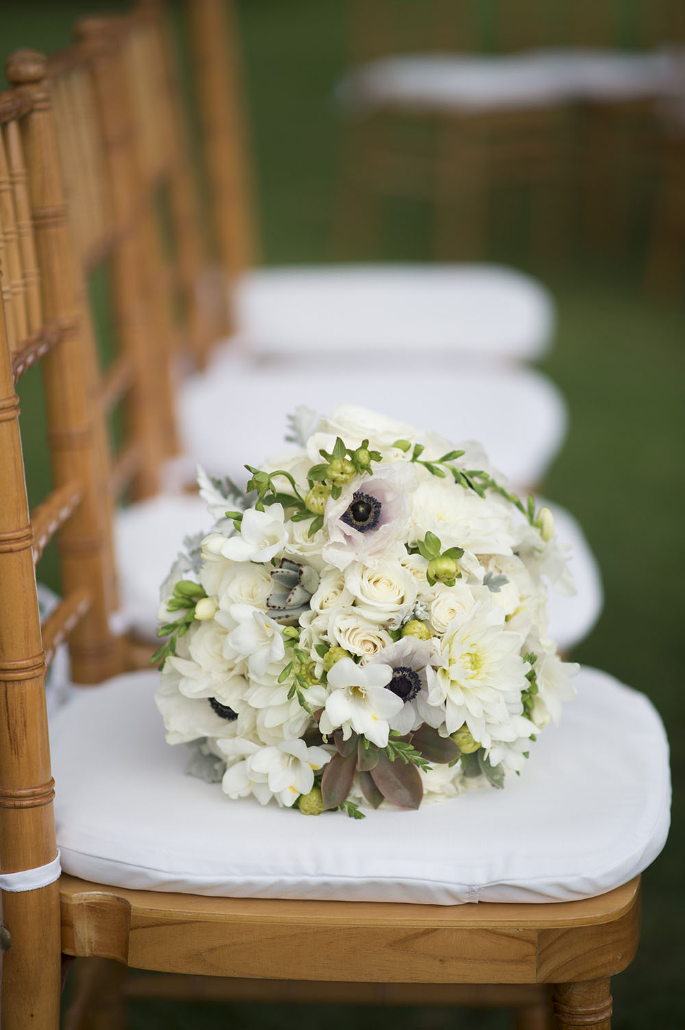 White bridal bouquet by Bliss Wedding Design - photo by Trish Barker Photography