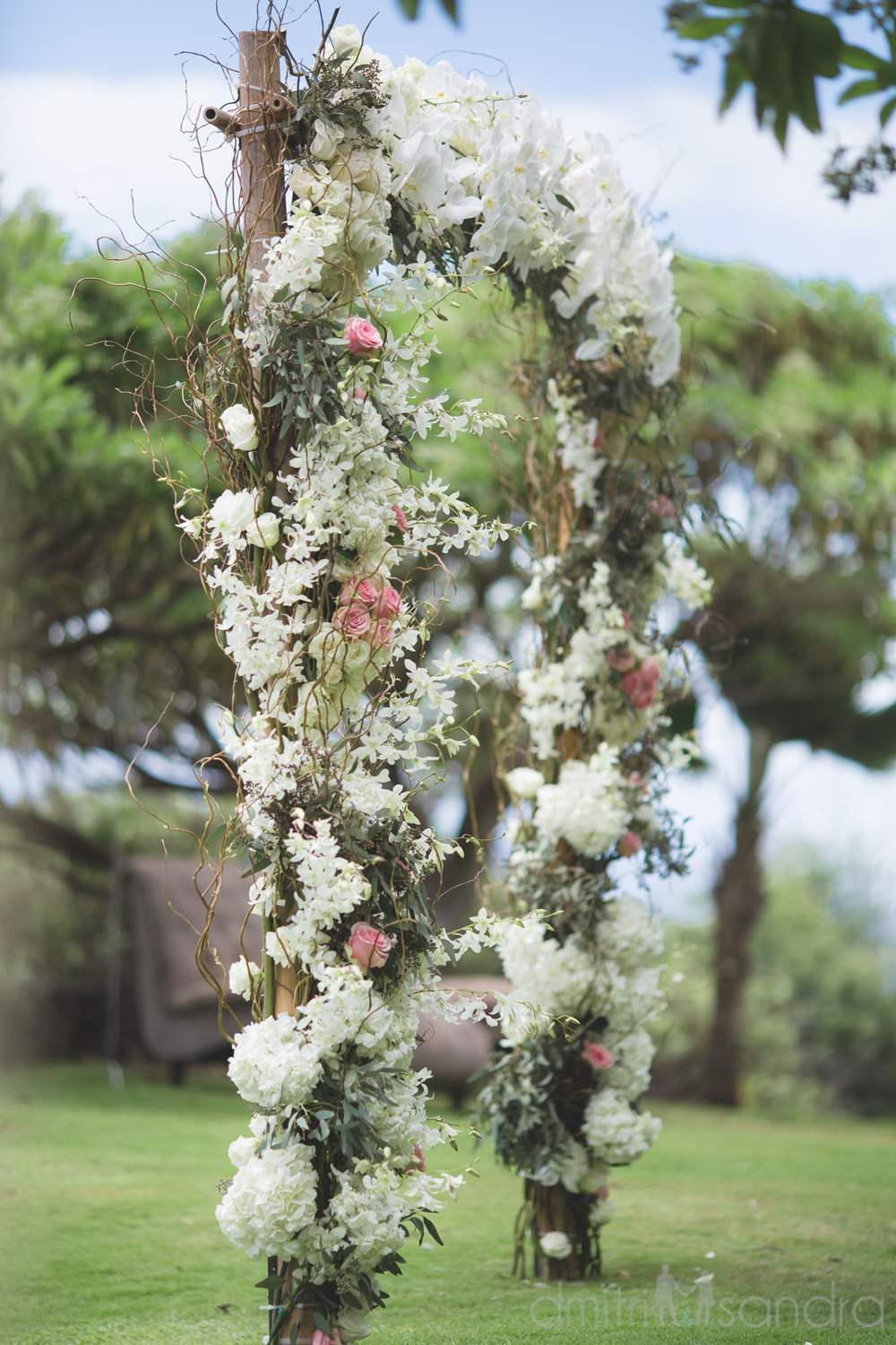 White floral ceremony arch by Bliss Wedding Design - photo by Dmitri and Sandra Photography