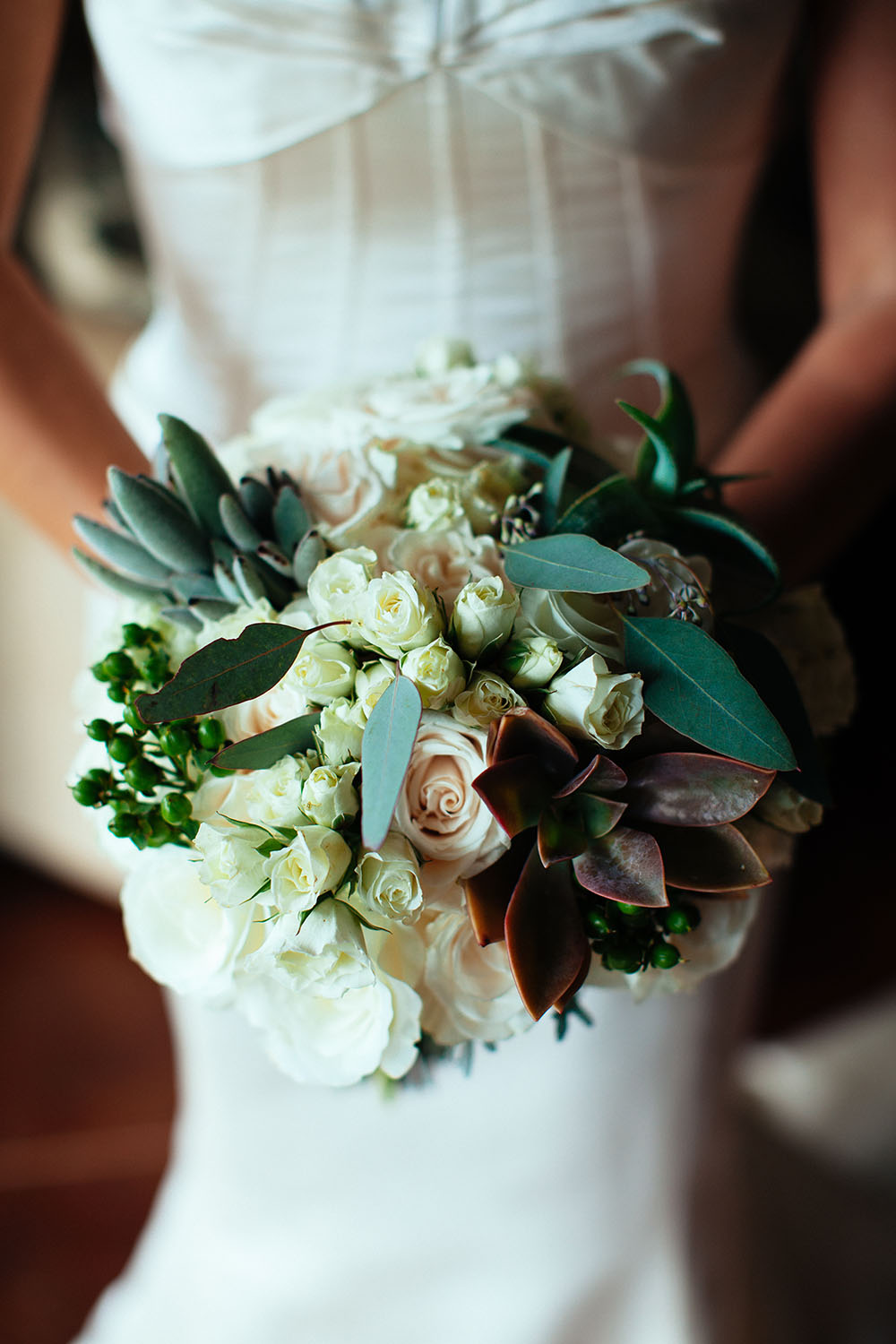 dramatic succulent bridal bouquet by Bliss Wedding Design - photo by Dmitri and Sandra White floral ceremony arch by Bliss Wedding Design - photo by Dmitri and Sandra Photography