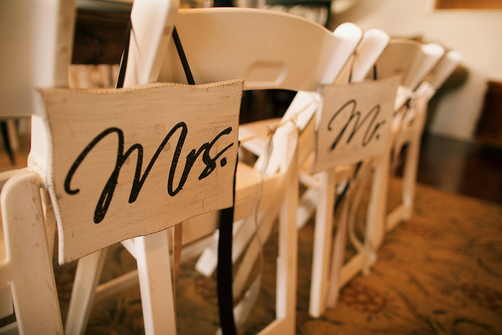 wedding reception seating with mr. and mrs. signs