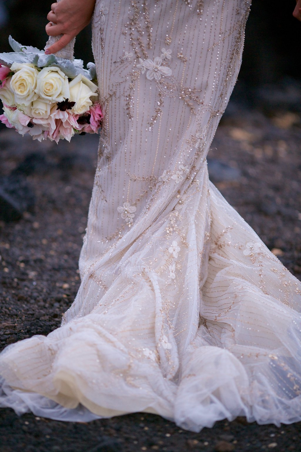 romantic beaded wedding dress and bouquet