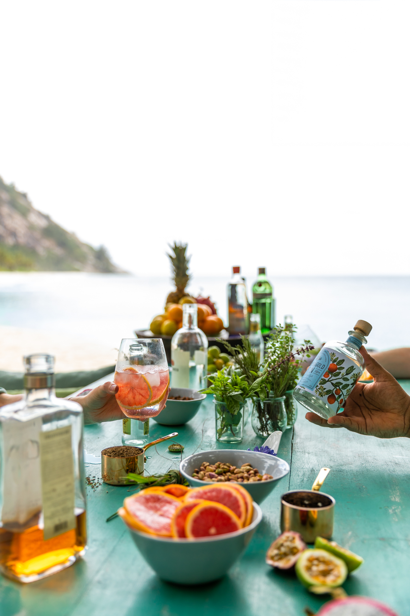 A colourful craft gin tasting at the Boardroom Table in the Piazza on a private island in the Seychelles