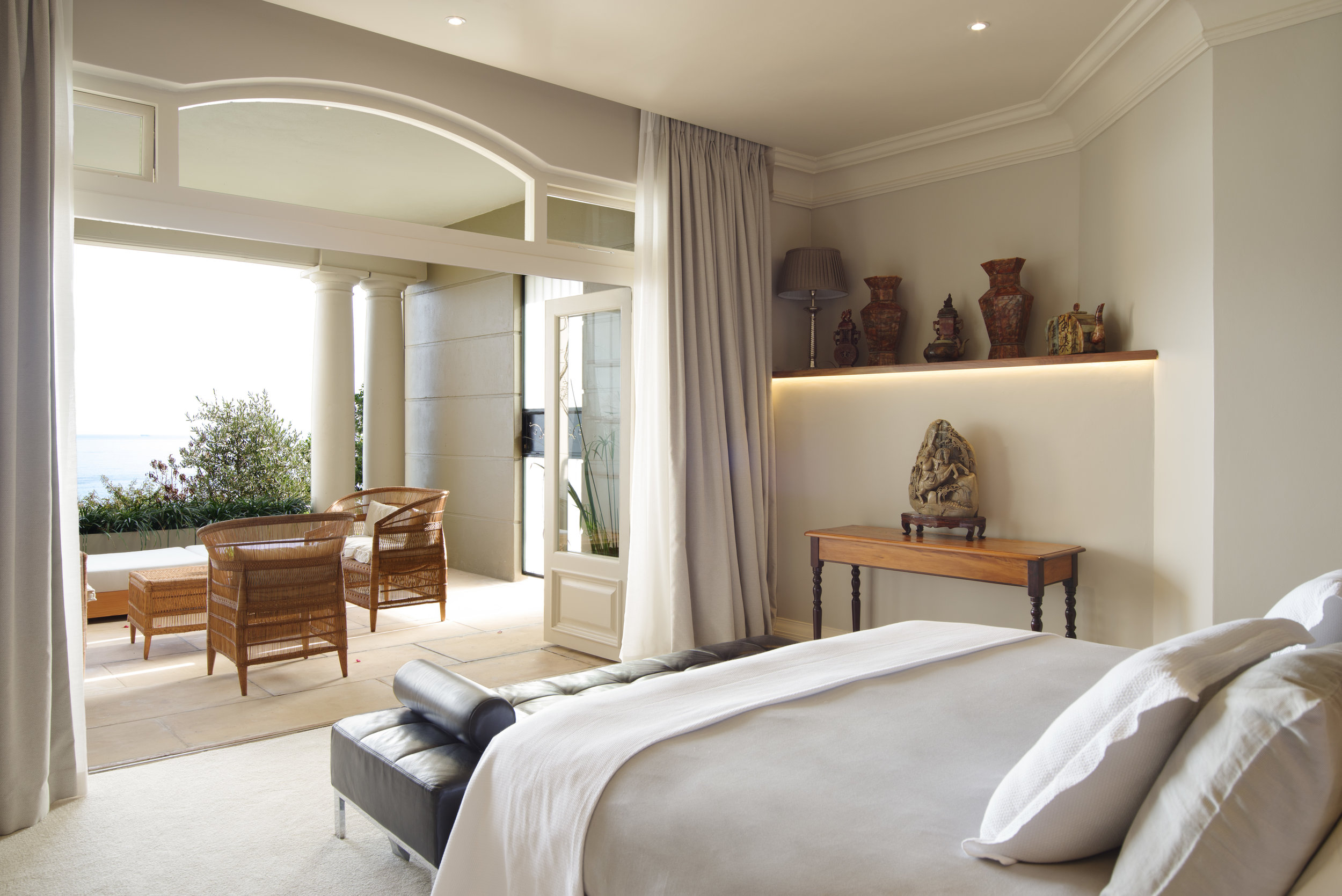 21 Nettleton Emporer Suite dressed in neutral tones looking out onto private balcony