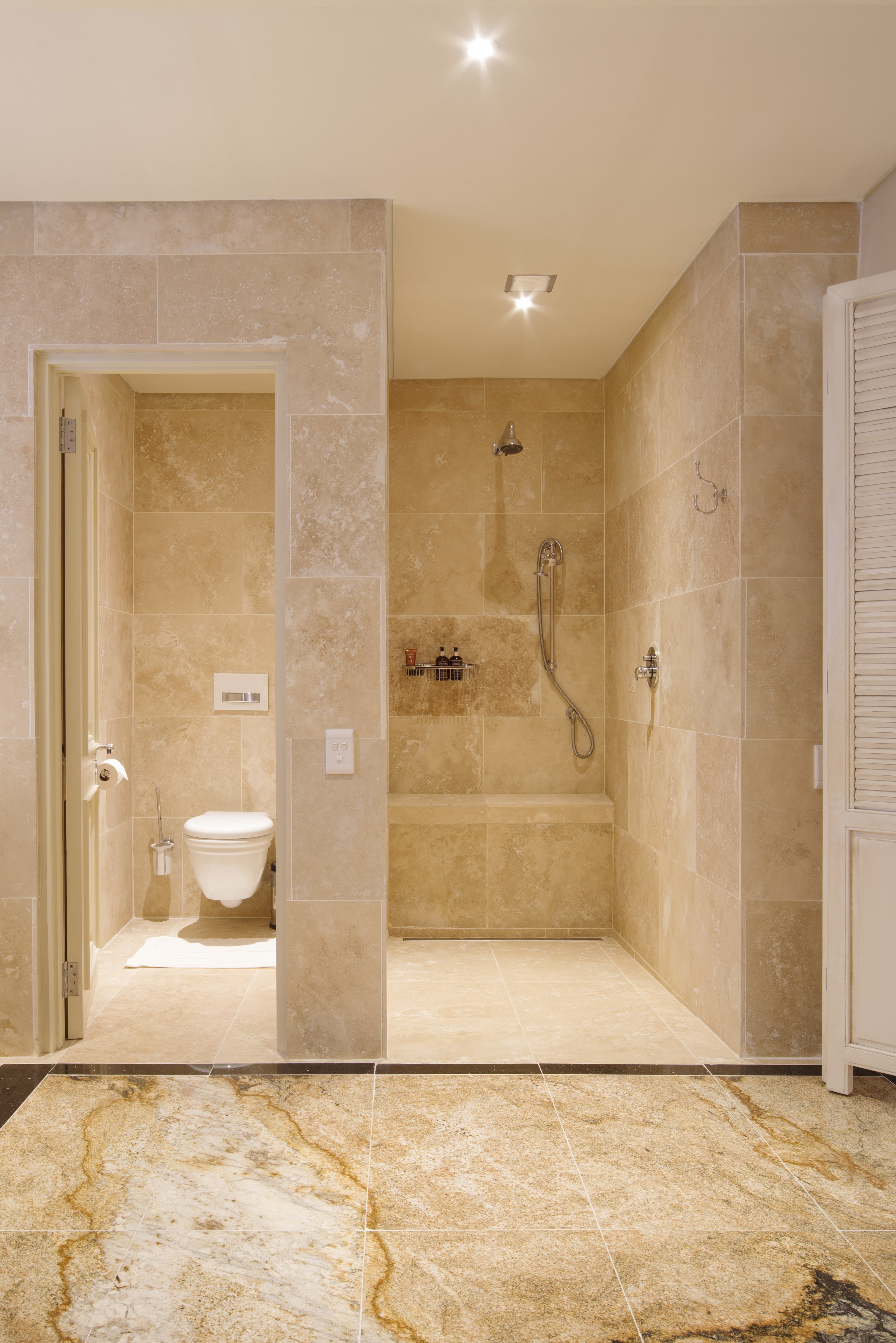 The walk-in shower and separate WC in the luxurious marble bathroom in the Emporer Suite at 21 Nettleton