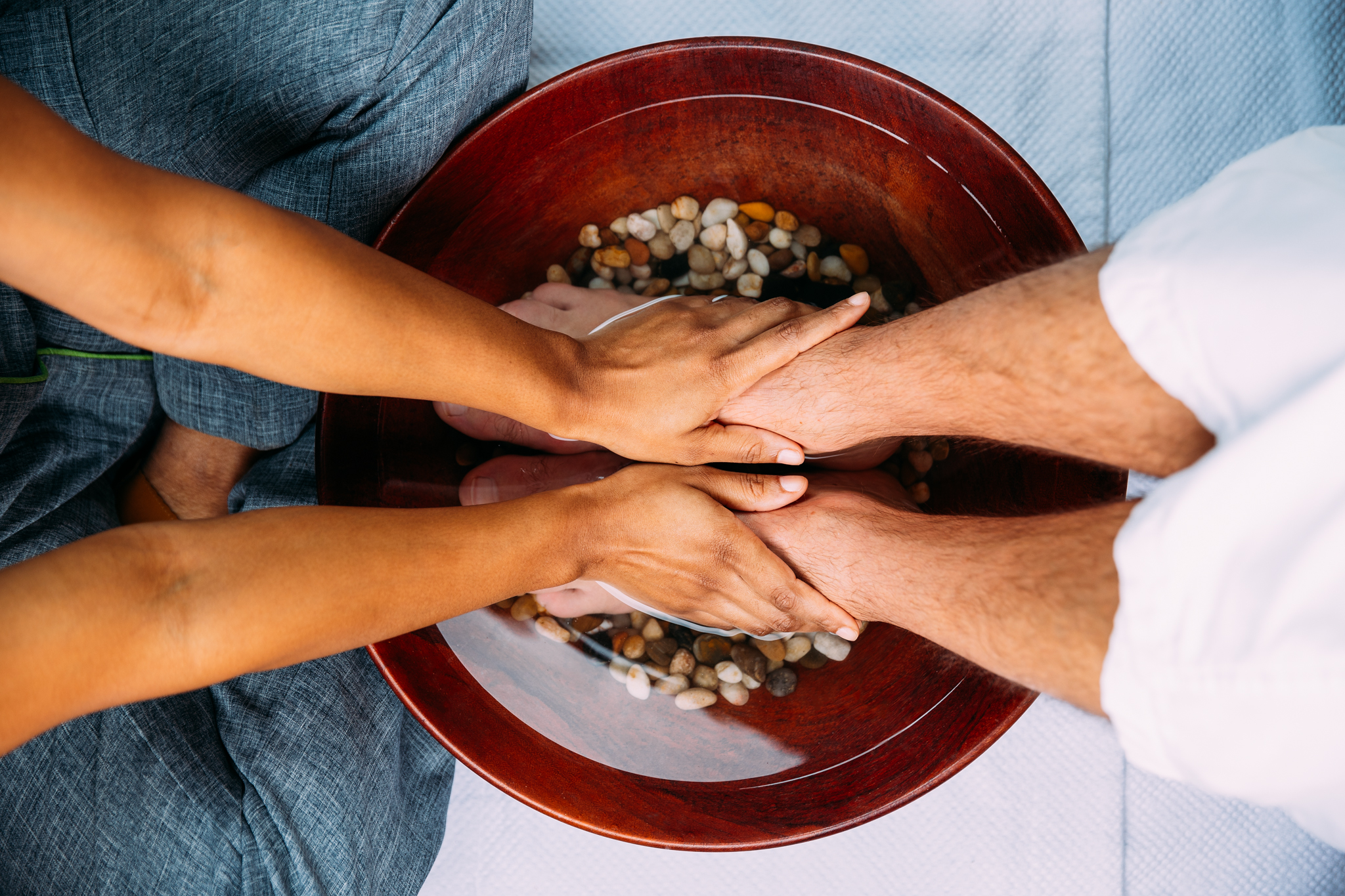 Delaire Graff Spa therapist's hands giving male a foot ritual