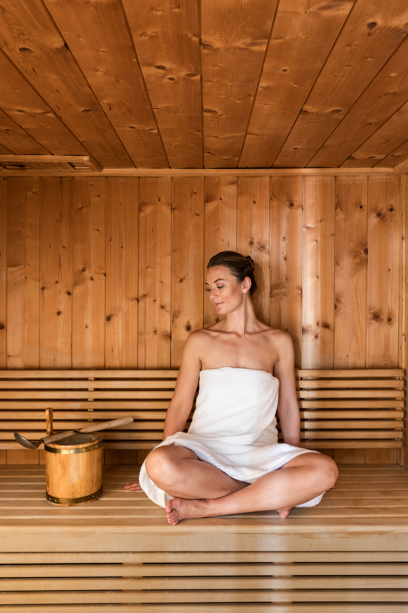 Girl relaxing in the sauna at Delaire Graff Spa