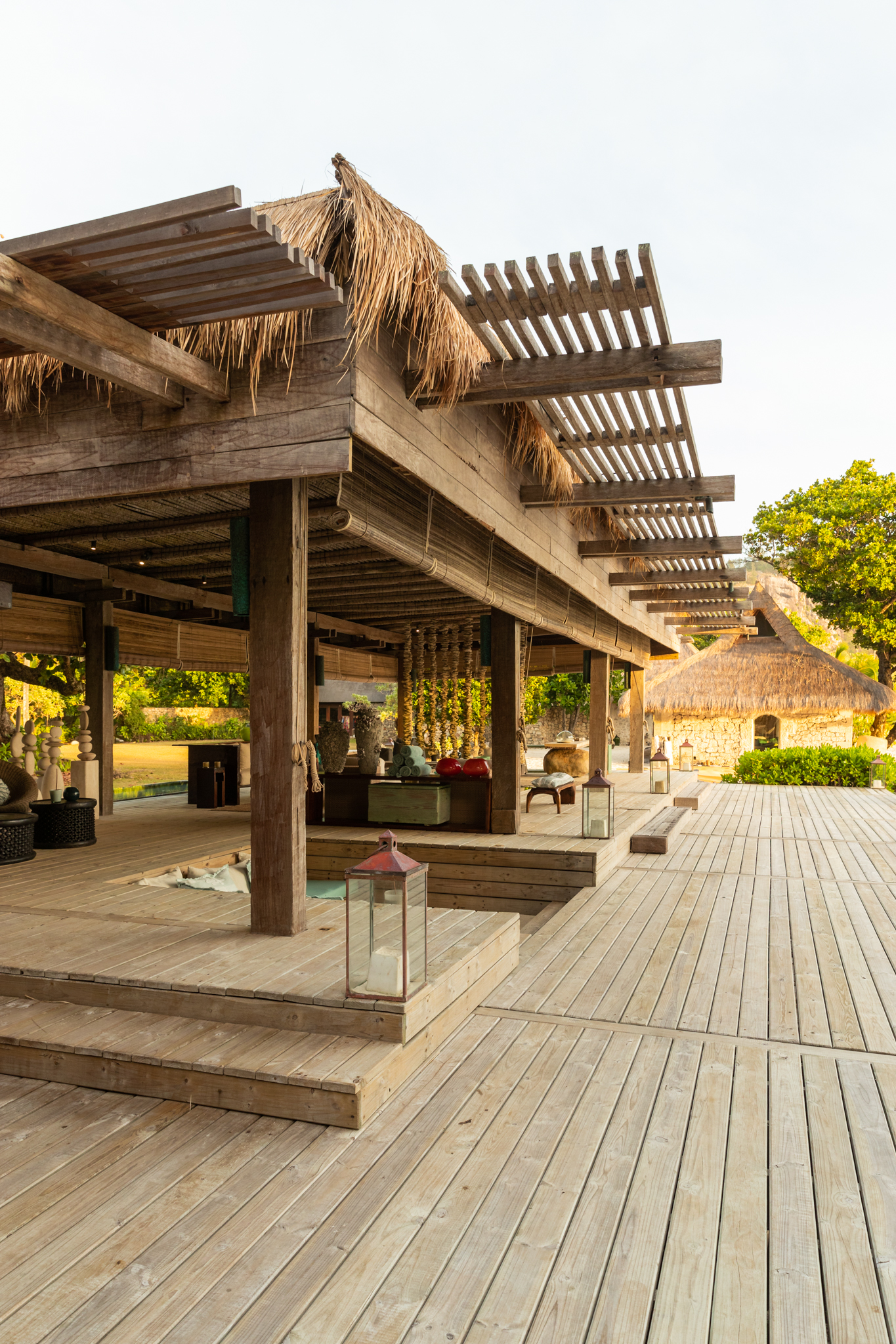 The Piazza on North Island has a comfortable lounge sunken into the wooden decks under a ylang ylang roof