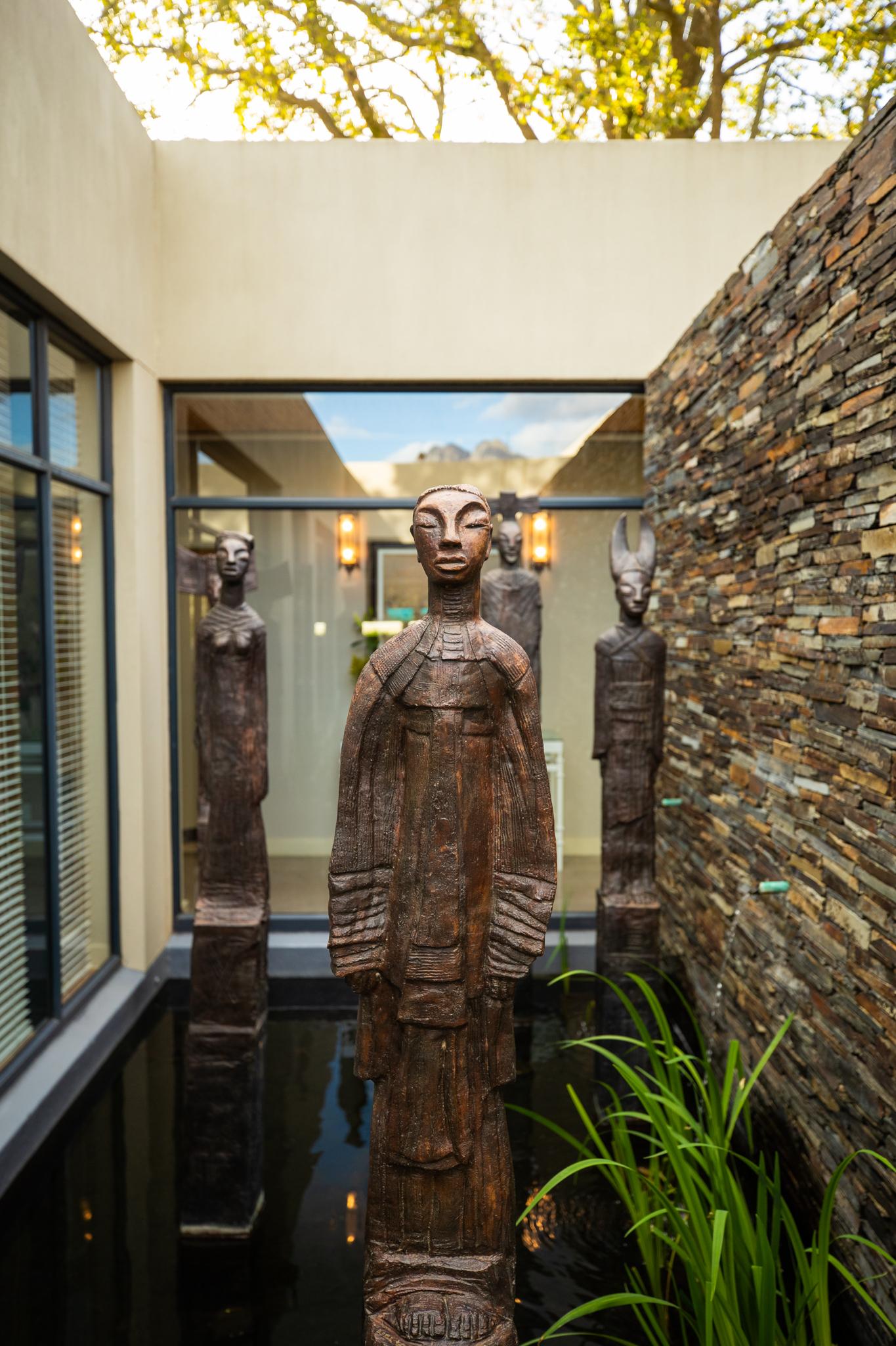 Deborah Bell sculptures grace the koi ponds at Delaire Graff Spa
