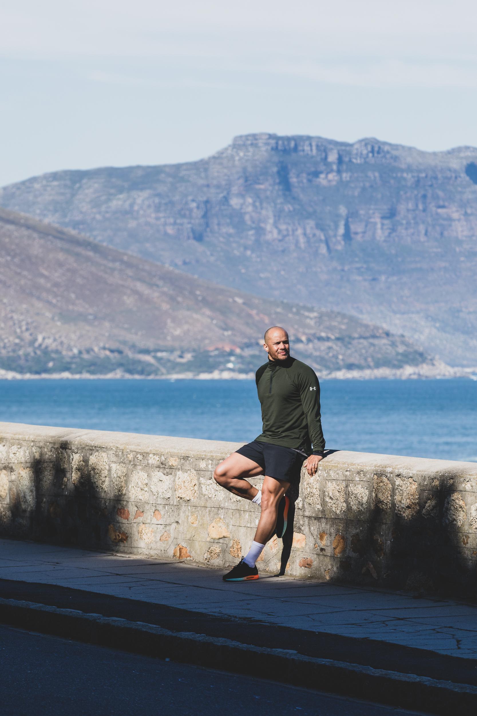 Harry Jameson stretching on Atlantic Seaboard coastline.