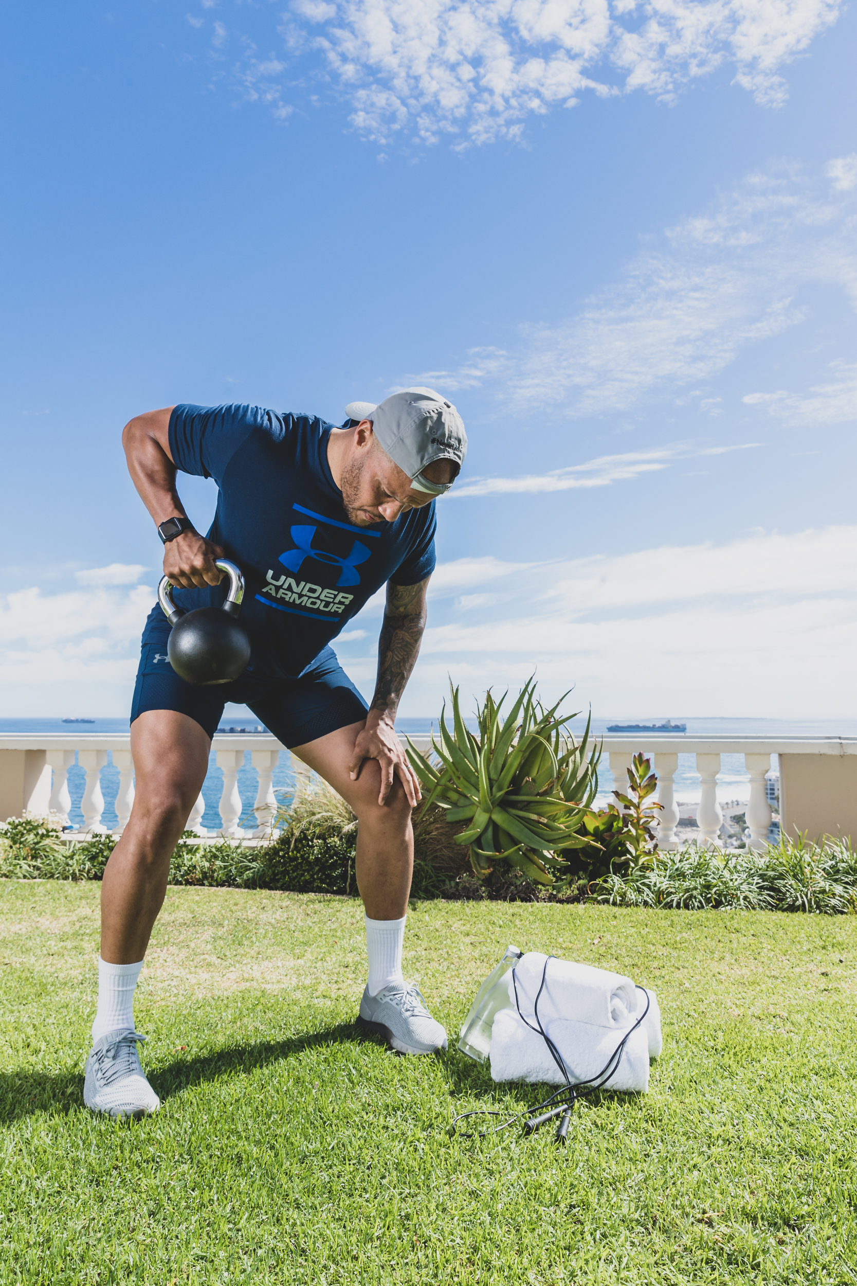 Harry Jameson performs kettle bell exercise at Ellerman House.