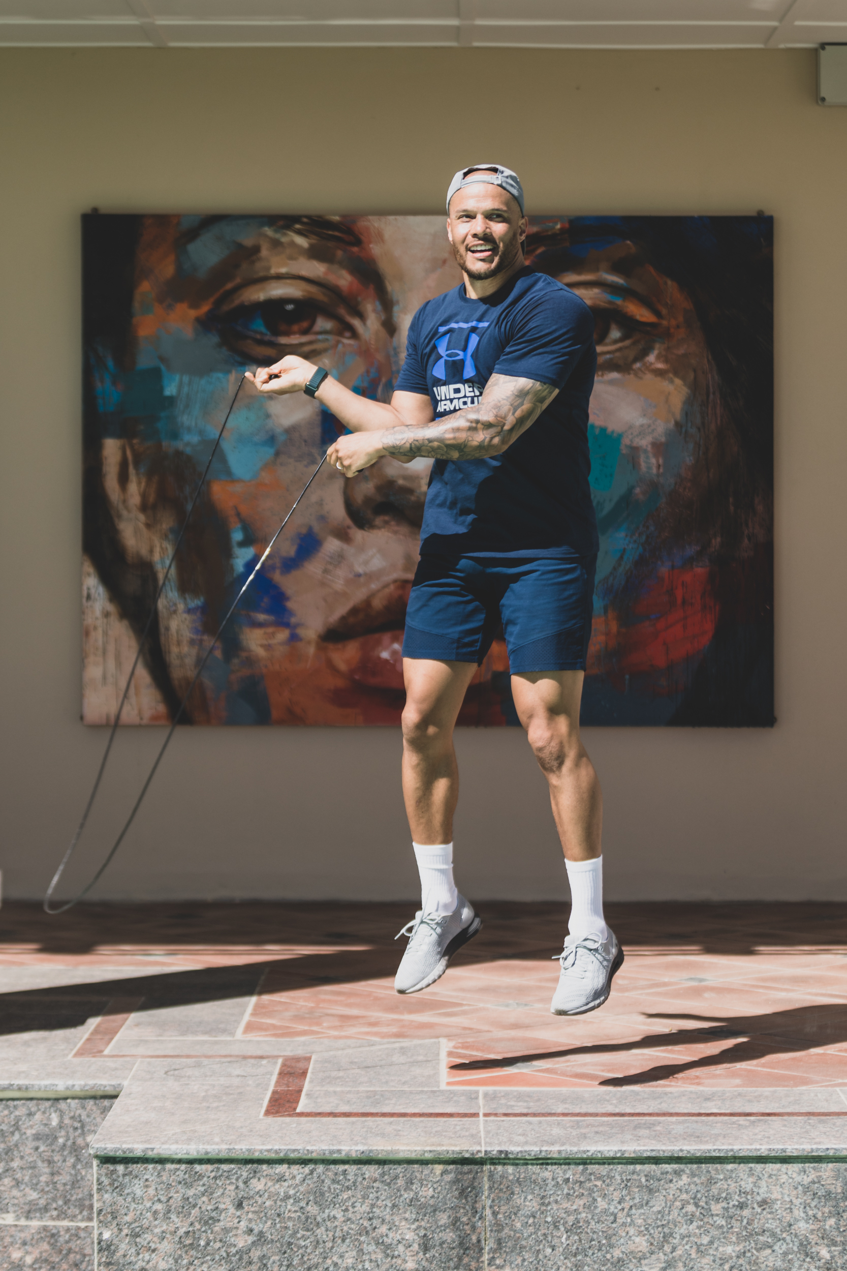 Harry Jameson skipping rope in front of Lionel Smit Artwork at Ellerman House.