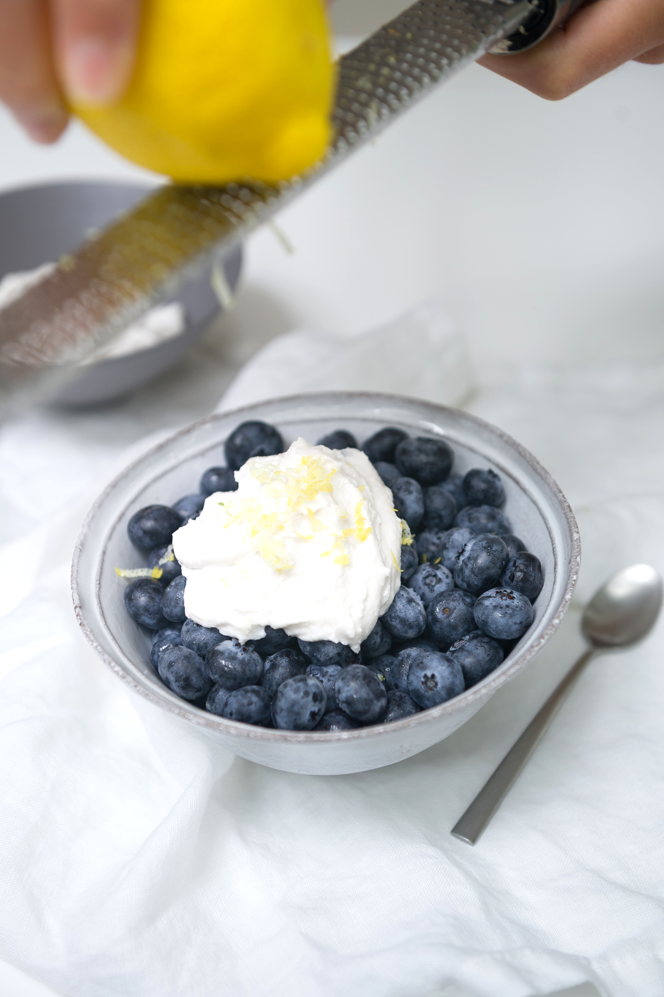 Blueberries with Whipped Coconut Cream and Lemon Zest. Raw, Vegan.