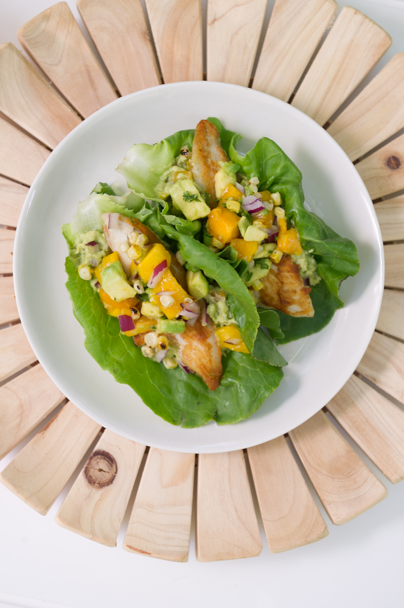 Tropical Fish Tacos wrapped in lettuce leaves. Dairy free, Pescetarian, Gluten free.