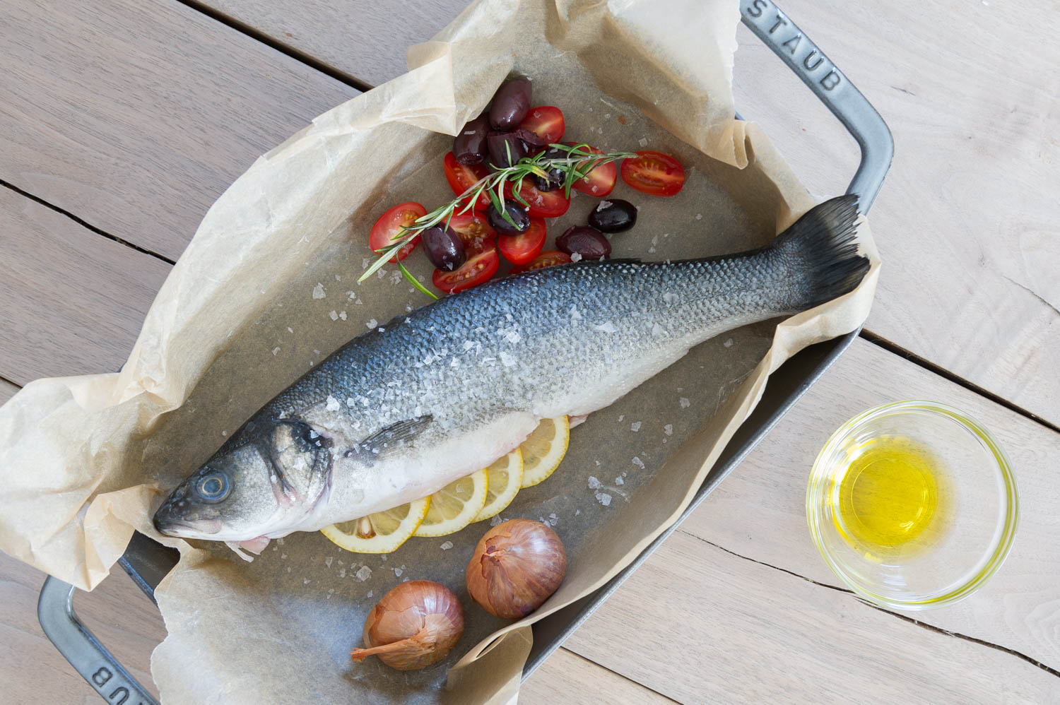 Roasted whole fish with olives. tomatoes and herbs recipe by Eat Real Food