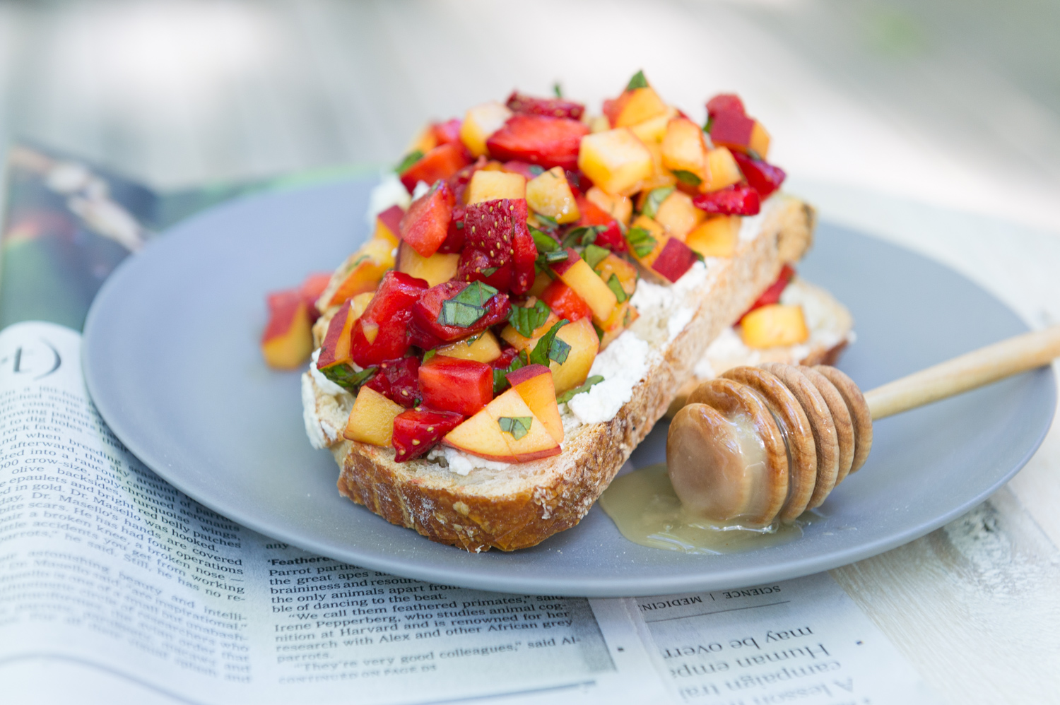 Strawberry and Peach breakfast bruschetta with fluffy ricotta and local honey recipe by Heather Cox of Eat Real Food