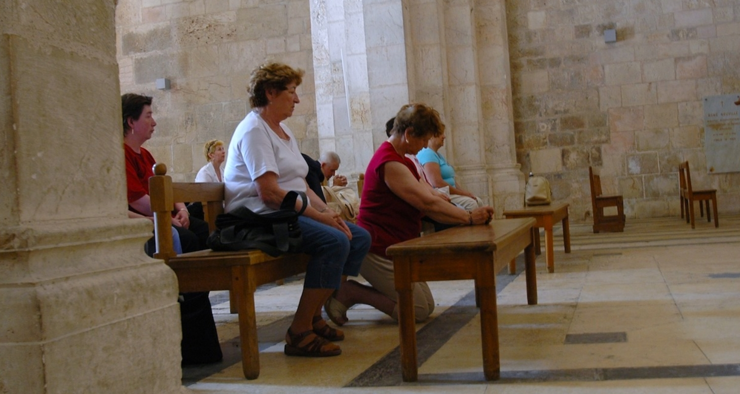Worshippers in the Crusader-era Church of St Anne, Jerusalem. Photograph by Mark Ziese.