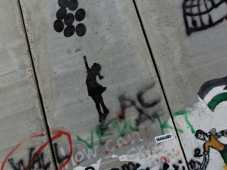 """A copy of """"Balloon Girl"""" by Bansky. Graffiti on the inside of the Great Barrier Wall. Bethlehem, Palestine."""