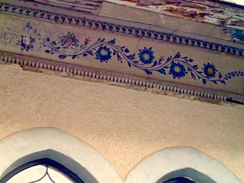 Detail of some of the painted decoration under the balcony's eave.