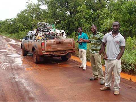 James, Austin, Isaac, and our loaded truck (right to left). Even a major highway like this one can be challenging in the rainy season.