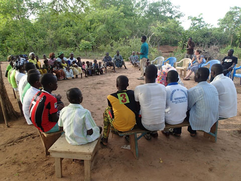 Isaac speaks to a gathering in Pulgnado. We are welcomed by the village elders (sitting just beyond Isaac).