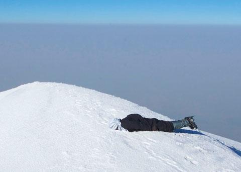 """Tanner """"planking"""" on the summit of Ağrı Dağı."""