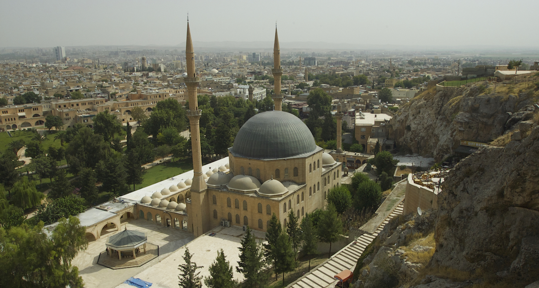 The mosque, the Dergah, and modern Urfa unfolds below.