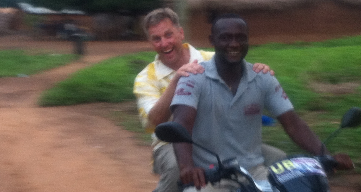 Joyriding through the village of Gulubi with James.
