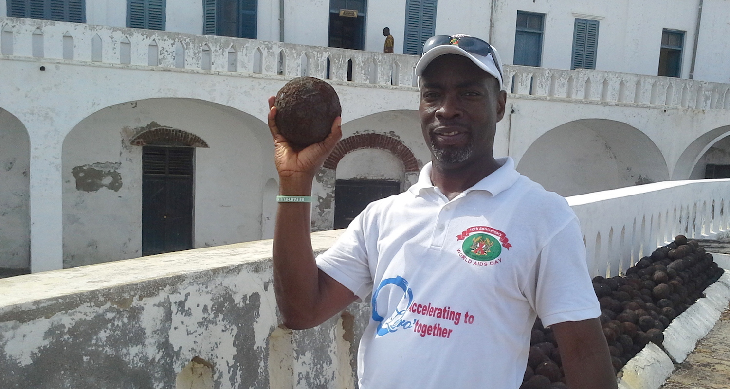 Edem thinks about launching a canon ball at Cape Coast Castle.