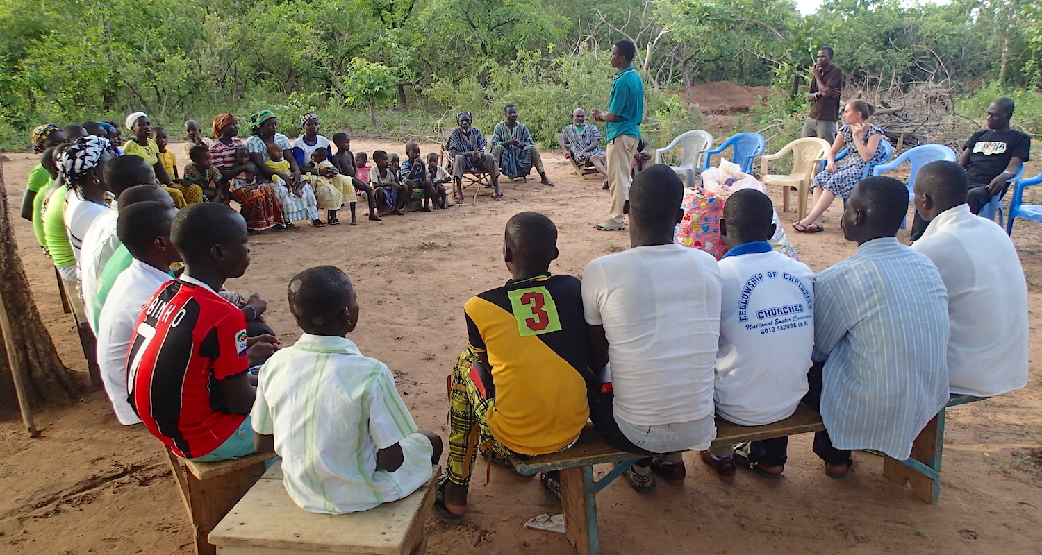 Isaac speaks to a gathering of believers in Pulgnando.