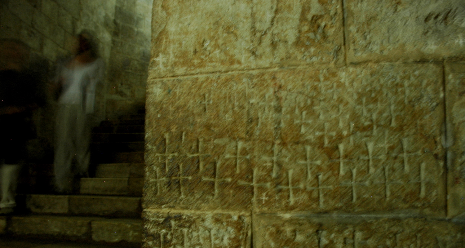 Carved crosses along the stair walls.