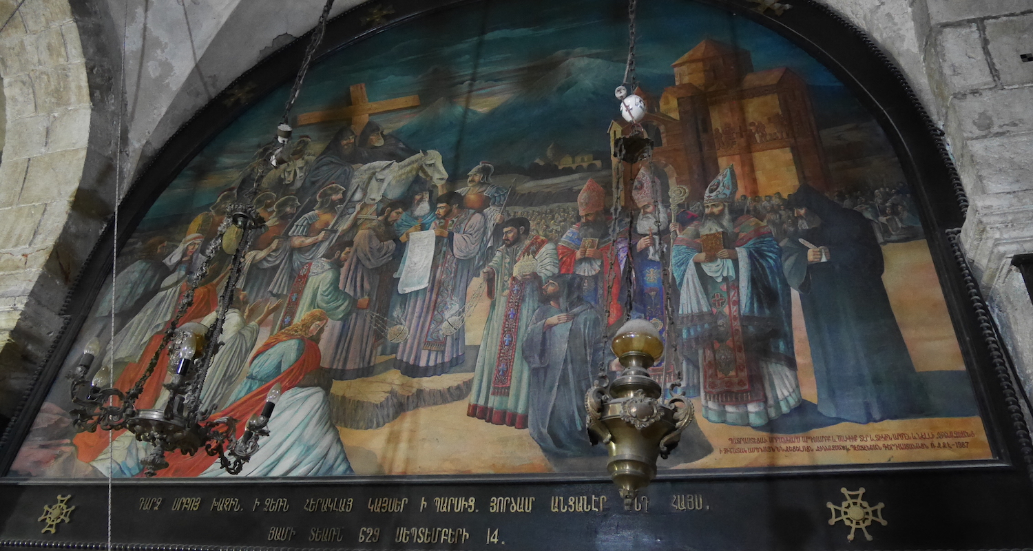 This mural on the south wall is fascinating. Note the stone church on the upper right that resembles the canopied altar structures of Helena and Demas. Several Armenian priests in black wear the peaked hat reminiscent of Mt. Ararat. Finally, in the background, the twin peaks of Greater and Lesser Ararat loom on the horizon.