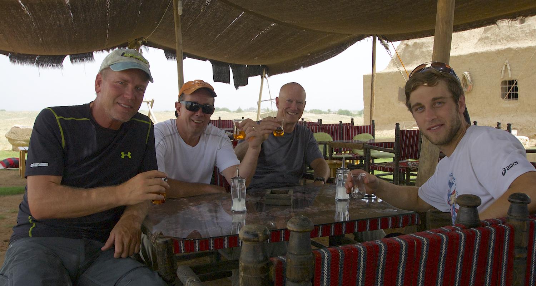 The boys sip apple tea, the ubiquitous drink of Turkey.