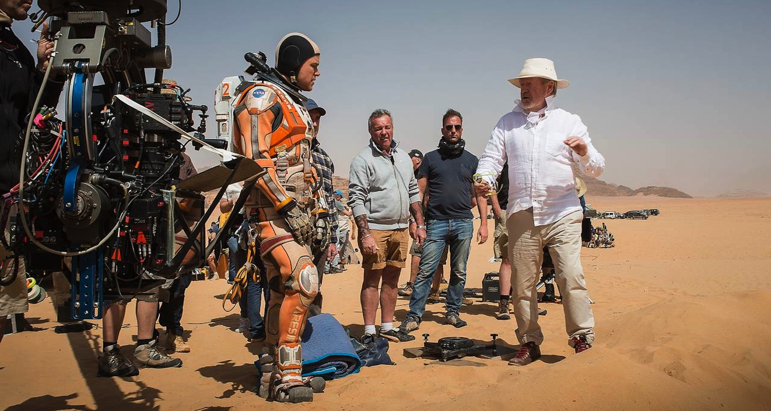Matt Damon receiving instructions from Ridley Scott. I don't buy it. If this were really Mars, wouldn't they be writhing on the ground, choking on their own tongues? Image from  here .