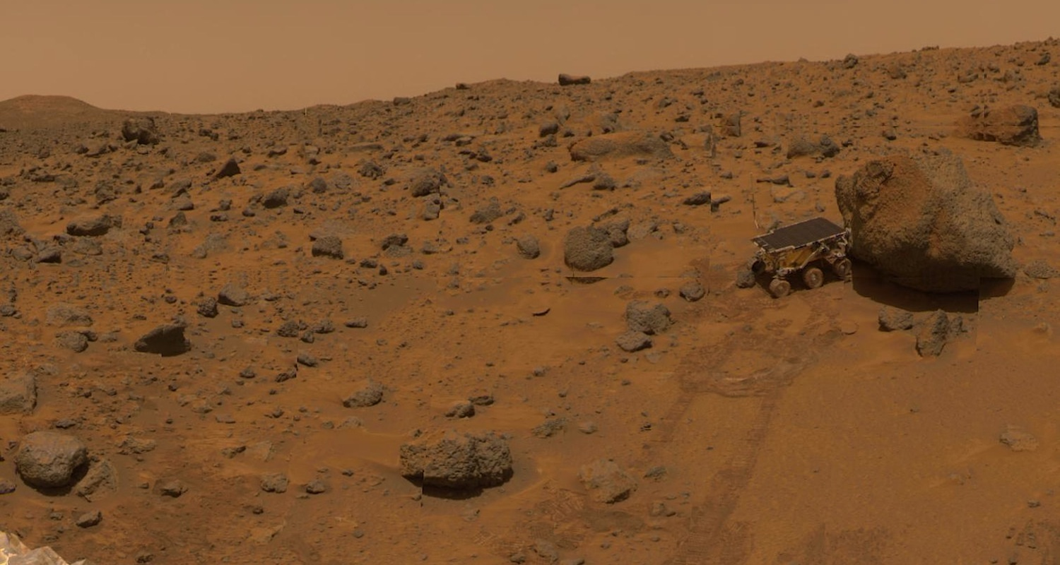 Behold the true surface of Mars. I think the little guy is stuck. Thanks, NASA. Image from  here .