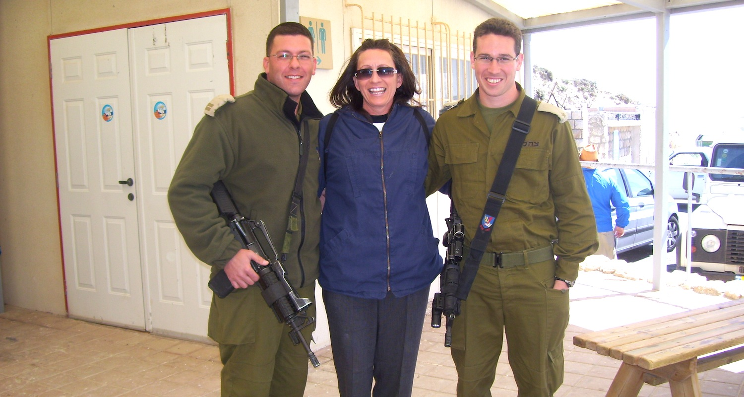 Susan, one of our pilgrims, poses with Israeli military.