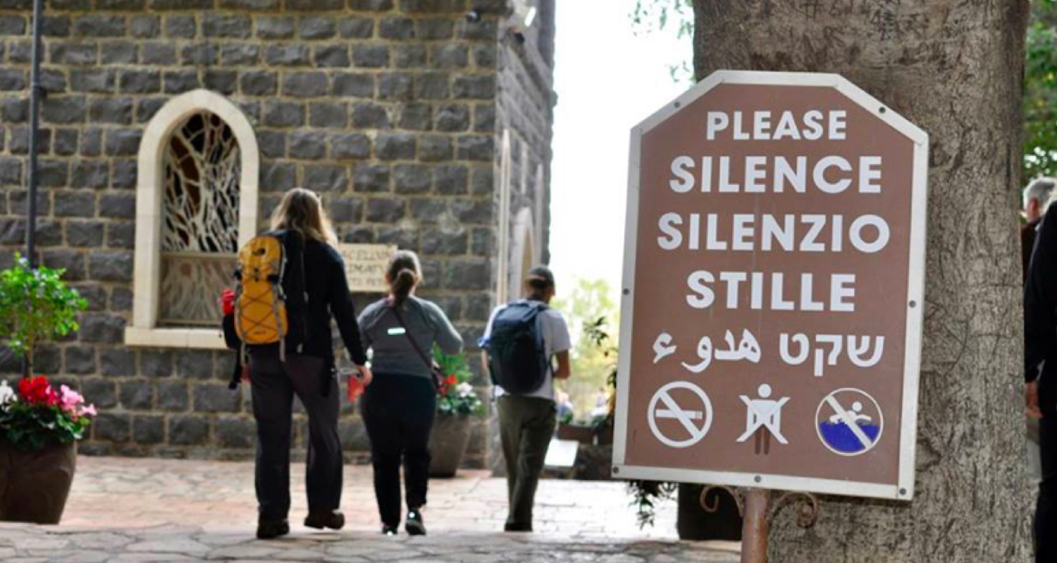 Signs call pilgrims to silent reflection.