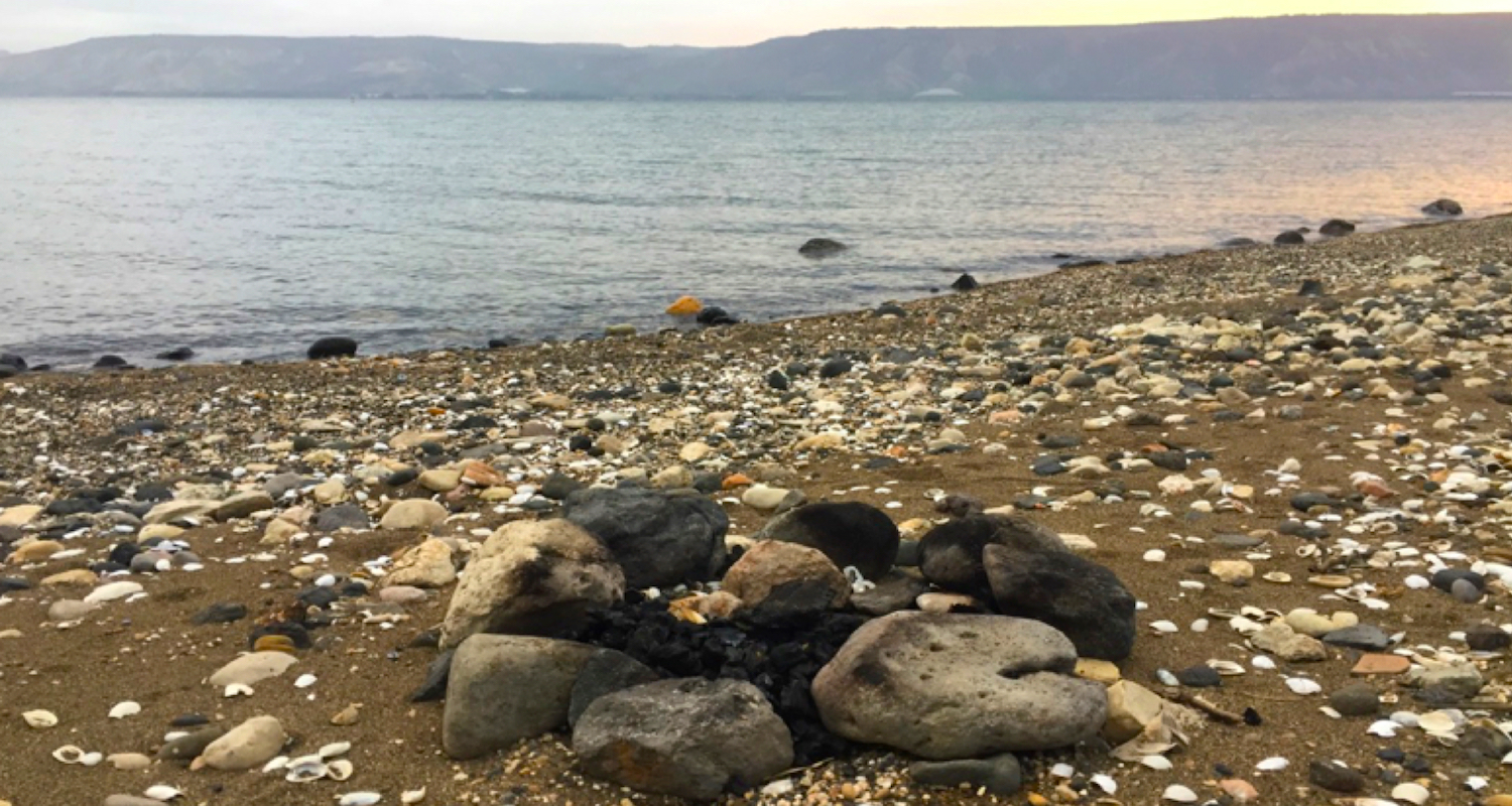 The remains of a fire along the Sea of Galilee.