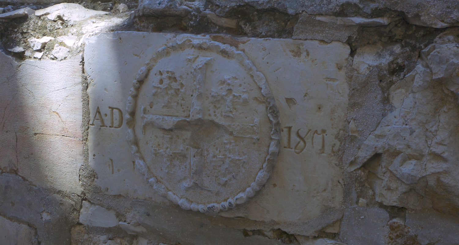 A carved medallion on a stone in the courtyard of the Church of All Nations. All Christians are welcome to this place which is held in trust by the Franciscan Custody of the Holy Land. Image by Mark Ziese.