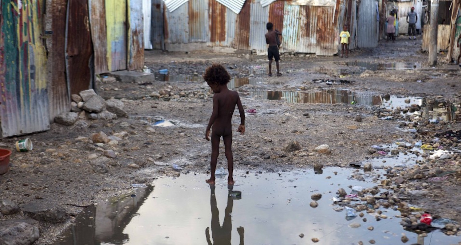 A child plays in a Hatian slum in advance of Hurricane Irma. Image from  here.