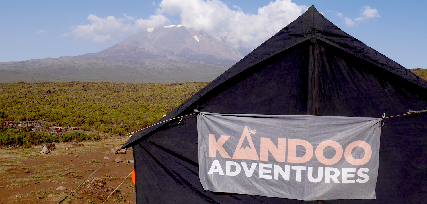 The Kandoo Adventures flag flying on the mess tent.