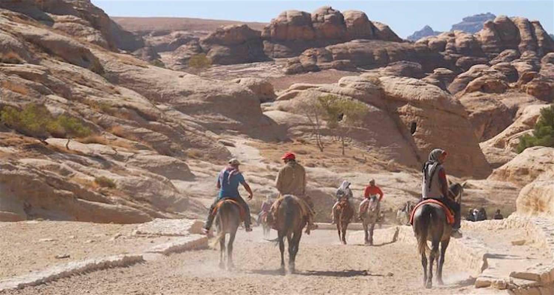 Riding into Petra, Jordan.