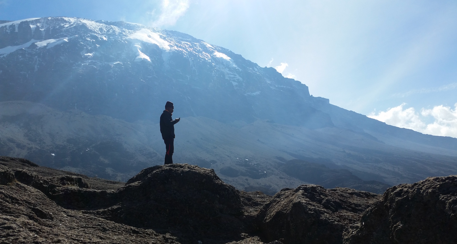 """""""And then he (Harry) knew that there was where he was going."""" In   """"The Snows of Kilimanjaro"""" Ernest Hemingway described the square top of the mountain as""""wide as all the world."""""""
