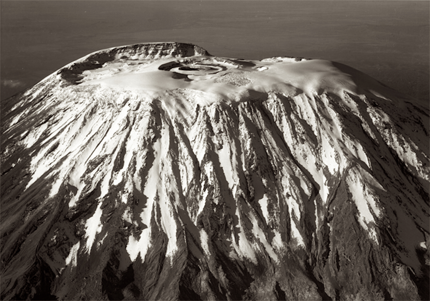 The iconic summit of Kibo, 1938. Reusch Crater forms a perfect circle on the top of the mountain. Image from  here .