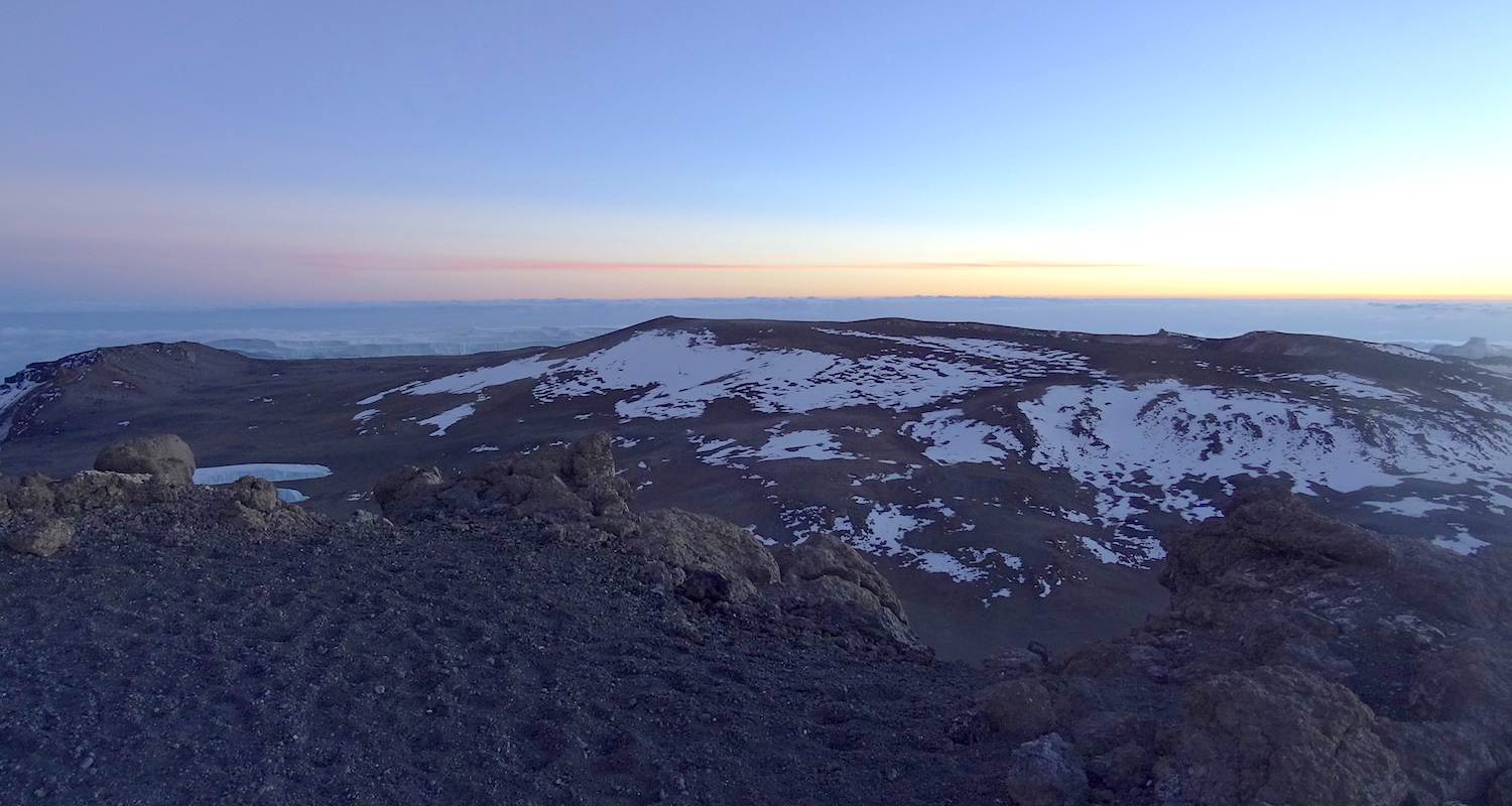Reusch Crater sits in the center of the Kibo's flattop. View from the summit. Image by team member Nico Roger.