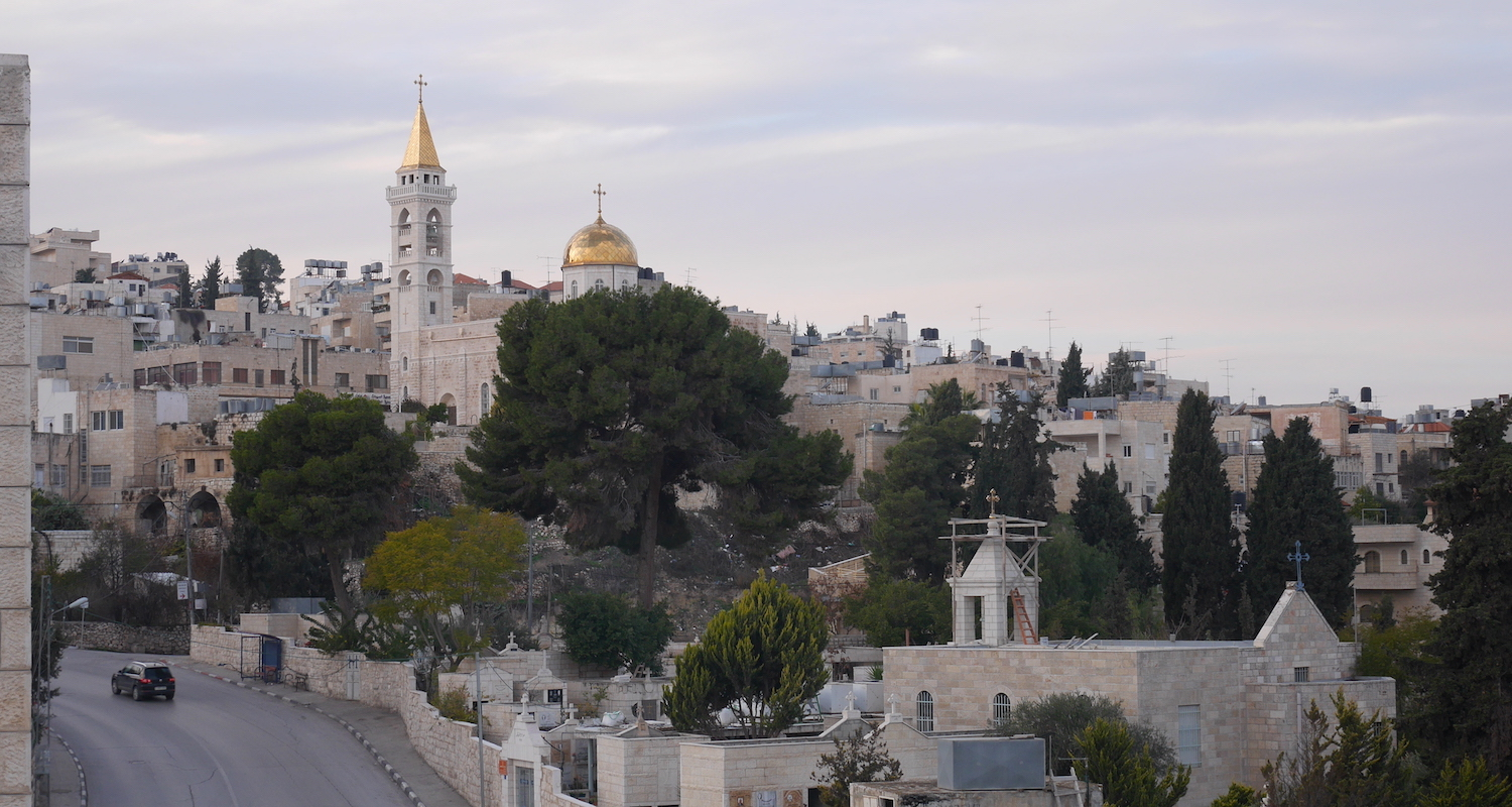 The village of Beyt Jala sits on a hill overlooking Bethlehem. The golden caps of the Church of Mar Nicola set it apart from the others.