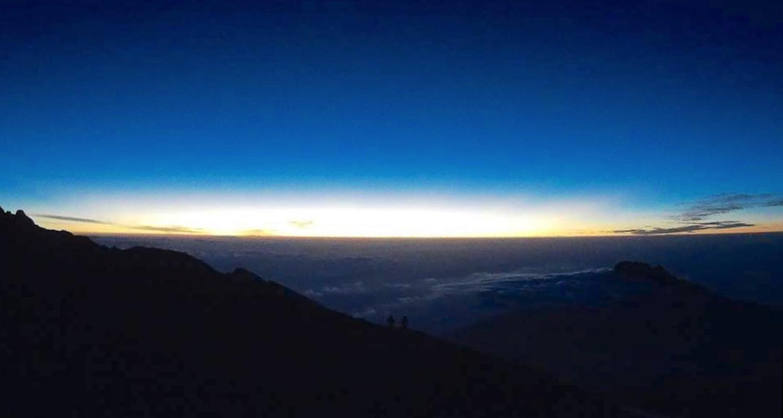 The sun rises on Kilimanjaro's rim. I think Rachel shot this image.